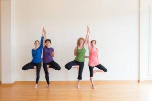 Four woman in Tree Pose.